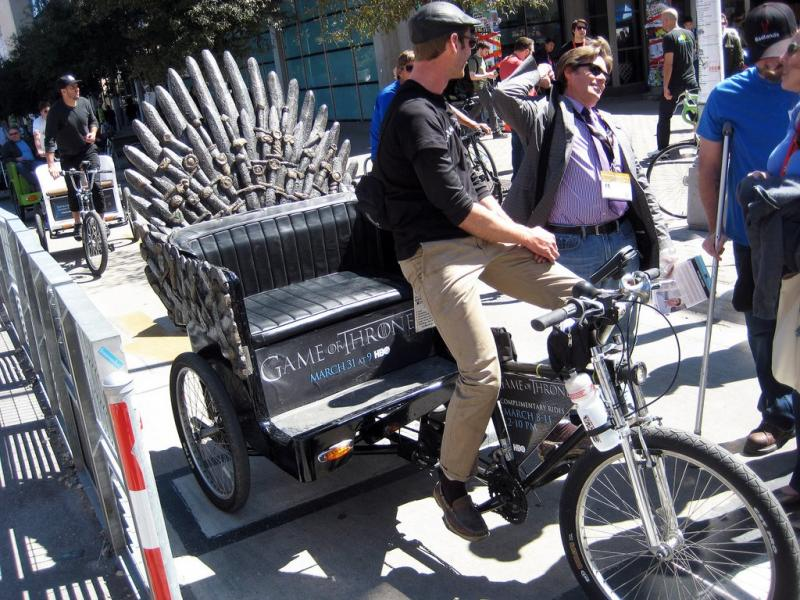 "This pedicab replicates the Iron Throne from HBO's fantasy series ""Game of Thrones."""