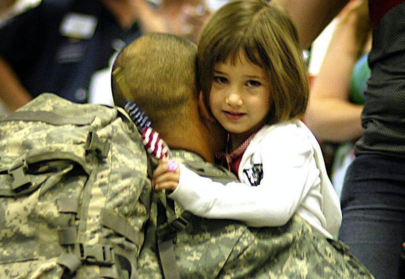 A U.S. Army Soldier hugs his daughter at the Dallas/Fort Worth International Airport in Texas April 3, 2007, after returning from Iraq.