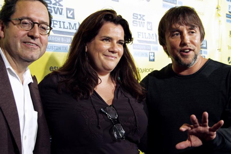 "Michael Barker, co-president and co-founder of Sony Picture Classics, with ""Before Midnight"" producer Sara Woodhatch and director Richard Linklater."