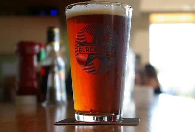 Brew pubs like Austin's Black Star Coop would be allowed to sell beer in stores under the tentative compromise.