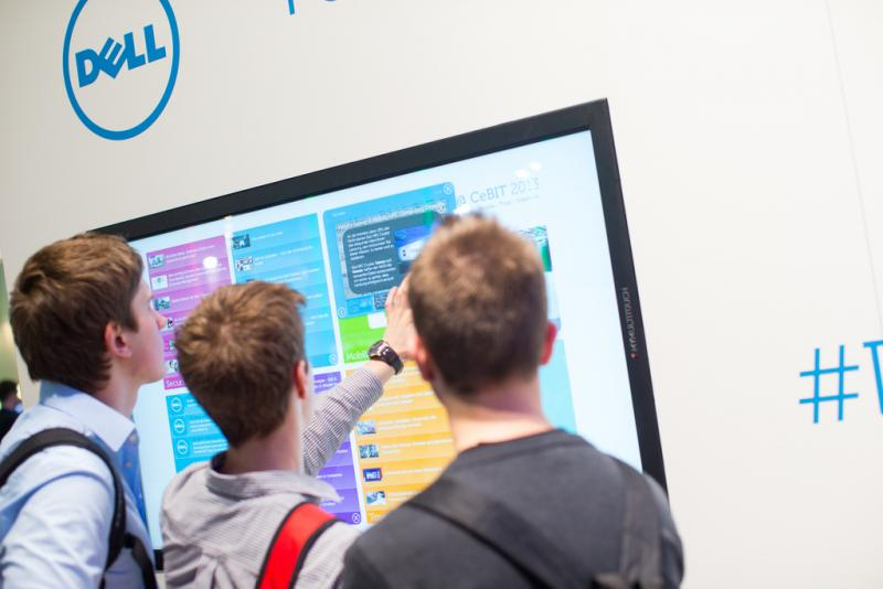 People examine a Dell display at the CeBit conference last week in Hanover, Germany