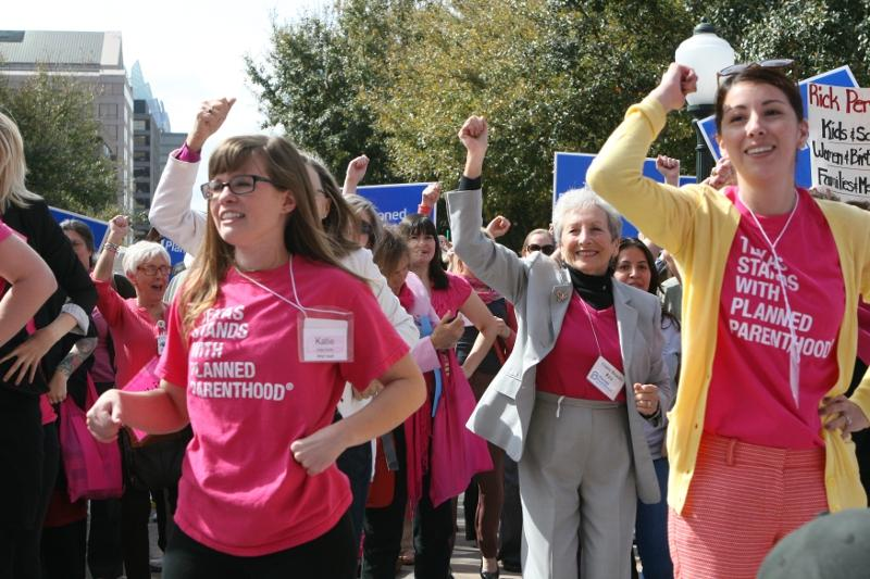 Supporters of Planned Parenthood rally at the Capitol.