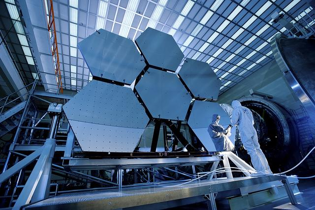 Ball Aerospace's Jake Lewis reflected in the James Webb Space Telescope's array. NASA has built a full-size model of the telescope for SXSW Interactive.
