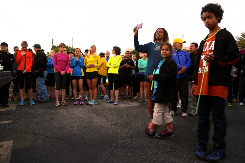Participants gather before the start of a run and walk in honor of the Boston Marathon victims on April 18, 2013.