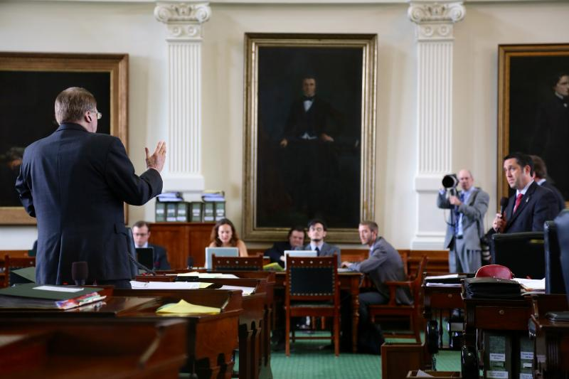 State Sen. Glenn Hegar, far right, responds to questions by State Sen. Brian Birdwell during a floor vote on April 30, 2013.