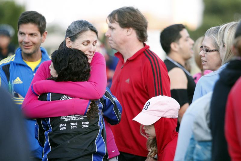 Friends Erin McGann and Bonnie Yesian embrace at a candlelight vigil for victims of the Boston Marathon bombing. Bonnie ran the marathon and was not far from the finish line when the bombs went off.
