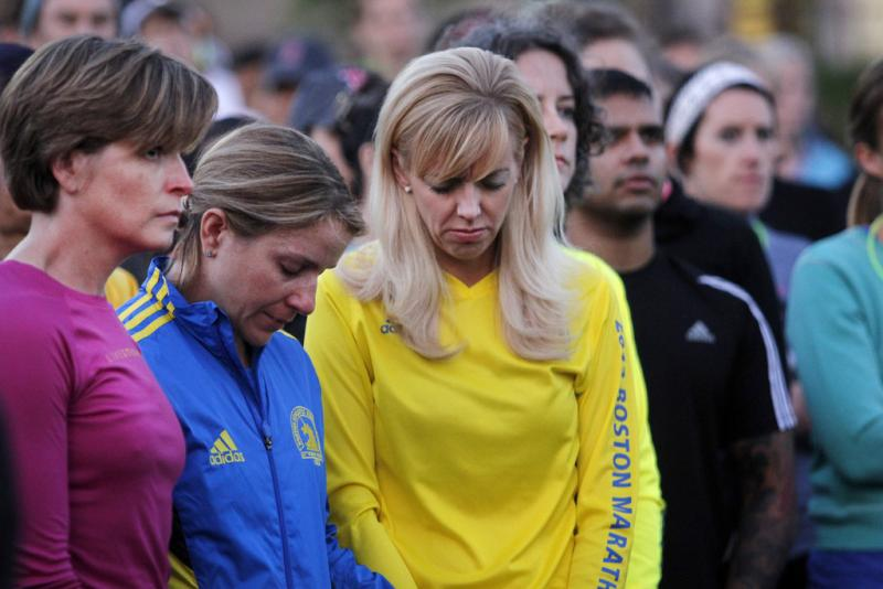 Austin runners pause for a 26.2-second moment of silence in memory of the Boston Marathon bombing victims.