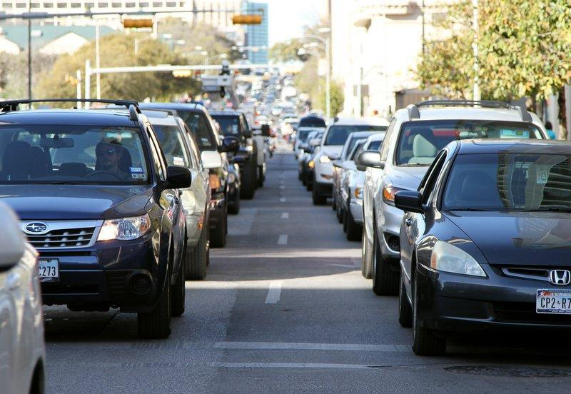Motorists stuck in downtown Austin. Freeway congestion has a ripple effect throughout the entire city.