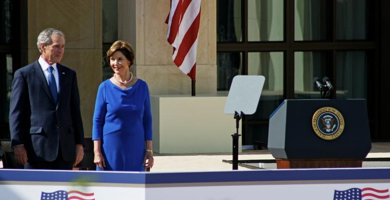 Former President George W. Bush and Former First Lady Laura Bush in front of the Bush Center in Dallas