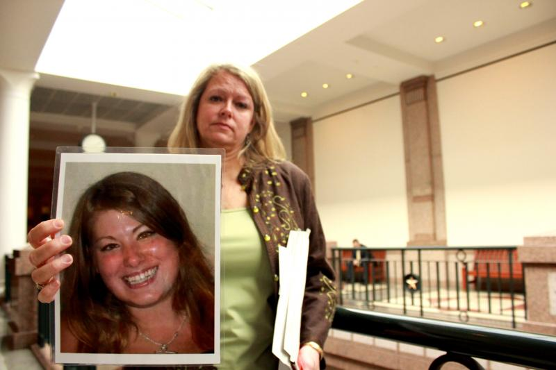 Kathy Bond of Fort Worth holds a picture of her daughter, Katrina Bond, at the Capitol on April 24, 2013. Katrina Bond died in 2011 from an accident allegedly involving texting while driving.