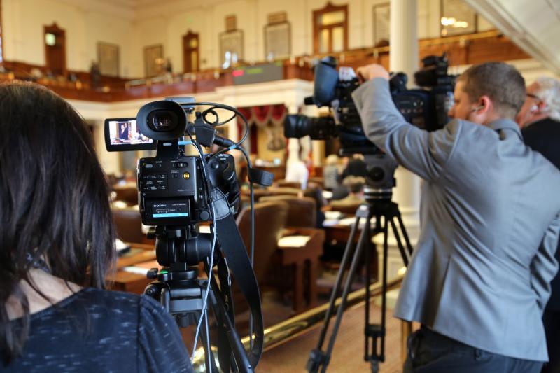 Members of the media cover the Texas House debate on gun legislation on May 4, 2013.