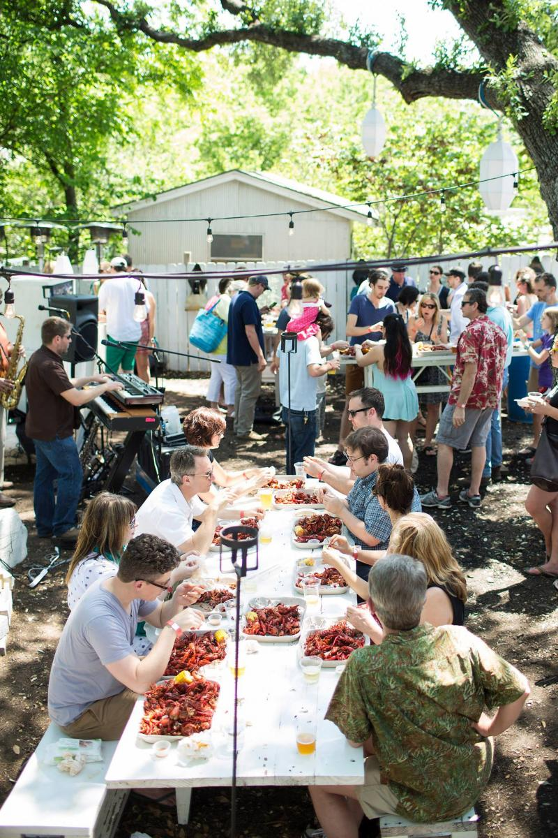 Diners enjoy a fundraiser crawfish boil at Lenoir in April, part of a series of events raising money for uninsured service industry workers.