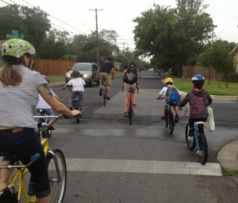 Rachel Houston, left, and some Brentwood Elementary students biking to school. Houston and her husband, Greg, lead a Bike Train every morning to school.