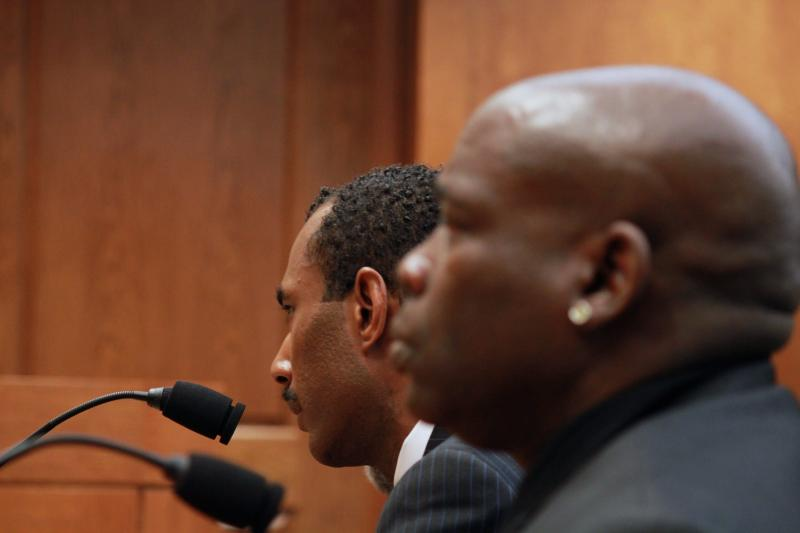 Cory Session, right, brother of wrongfully convicted and exonerated Texan Timothy Cole, testifies during a committee hearing on May 14, 2013.