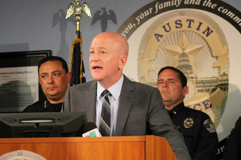 U.S. Attorney Robert Pitman (center) and Austin Police Chief Art Acevedo (left) at a press conference on May 30, 2013.