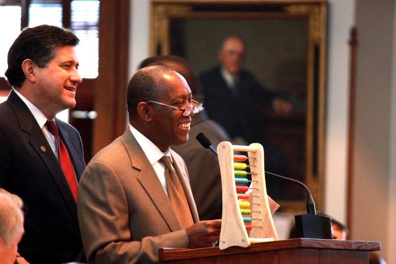 Rep. Sylvester Turner at the podium uses a wooden abacus during debate on the Texas House floor on May 7, 2013.