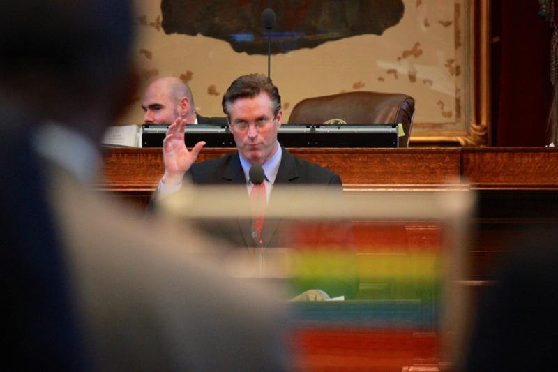 Rep. Harvey Hilderbran answers questions from Rep. Sylvester Turner, behind the wooden abacus, during a Texas House debate on May 7, 2013.