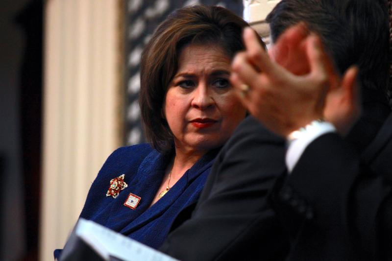 State Sen. Leticia Van de Putte, D-San Antonio, speaks with Gov. Rick Perry during a ceremony for fallen military members on May 25, 2013.