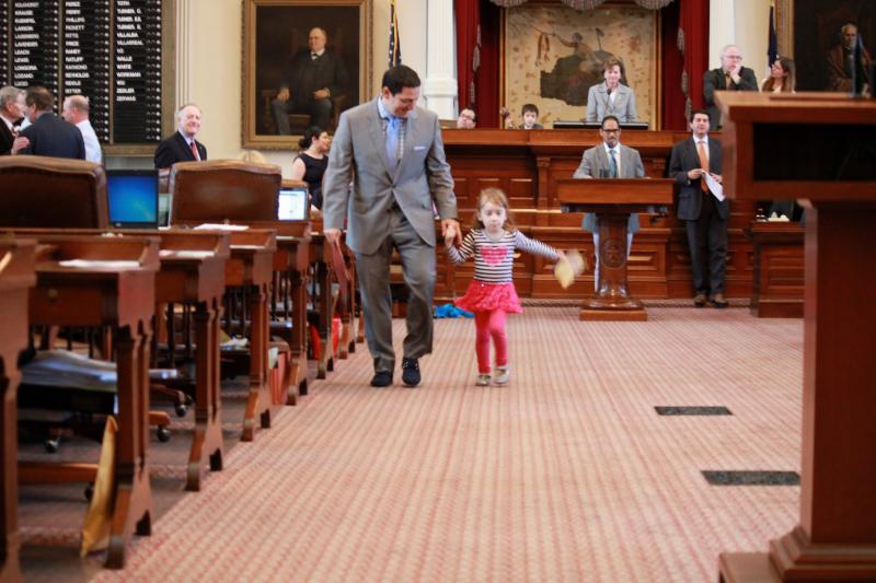 State Rep. Trey Martinez-Fischer walks with his daughter, Francesca, 4, on May 27, 2013.
