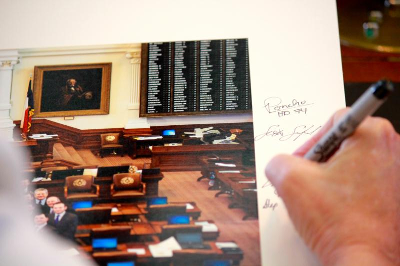 State Rep. Stephanie Klick, R-Fort Worth, signs a photograph of the 83rd Legislature on May 26, 2013.