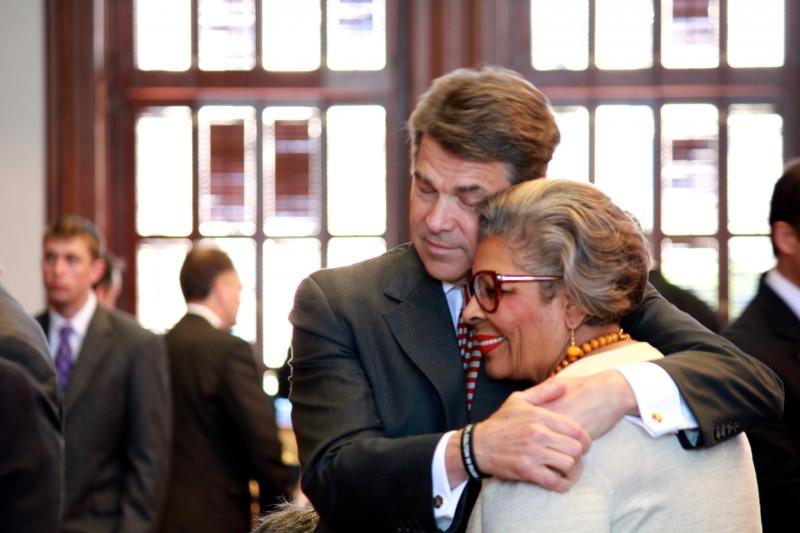 Gov. Rick Perry hugs State Rep. Senfronia Thompson, D-Houston, during his rare visit to the House floor on May 13, 2013.