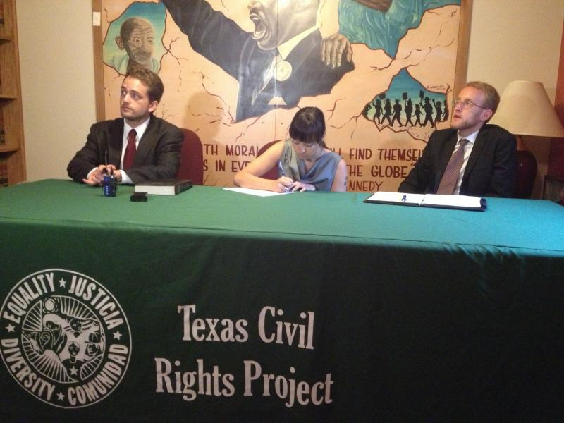 Brian McGiverin, attorney at Texas Civil Rights Project, Kymberlie Quong Charles of Grassroots Leadership and Bob Libal, director of Grassroots Leadership get ready to address their lawsuit against the Corrections Corporation of America.