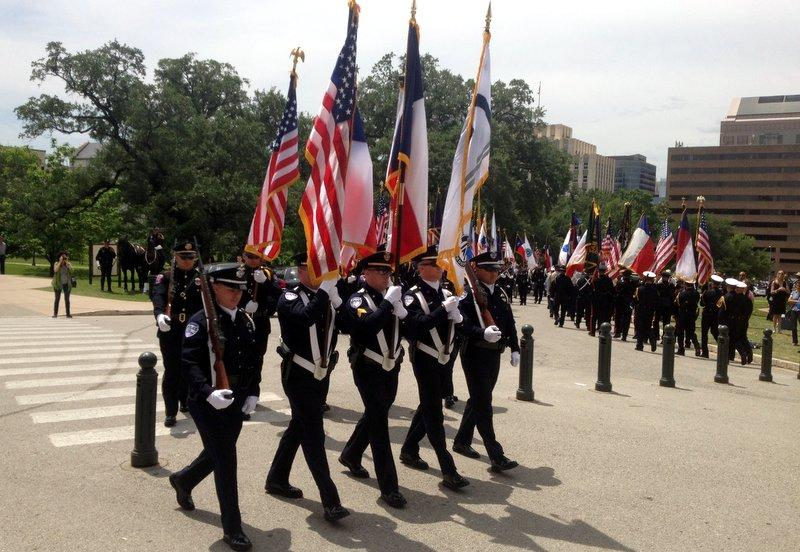 Law enforcement officers take part in a memorial parade in honor of peace officers who have died in the past two years.