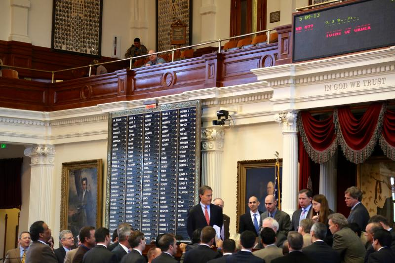 Texas House members gather on May 4, 2013, to discuss a point of order during  debate on a concealed handgun bill.