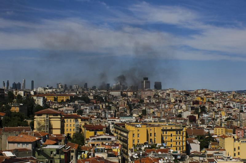 Smoke from fires burning in Taksim Square billows over the skyline of Istanbul at 3 p.m. on Tuesday afternoon.