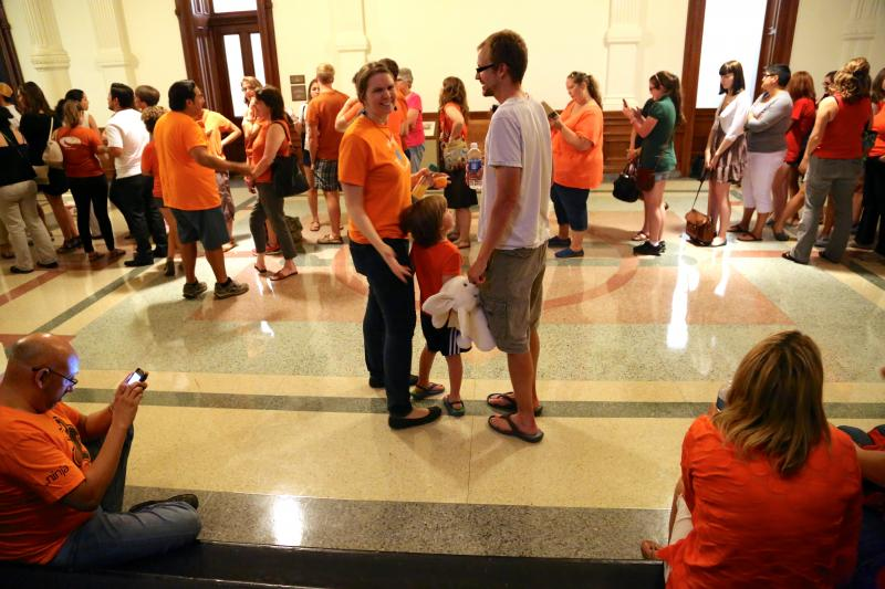 People of all ages lined up throughout the floors of the Texas Capitol for a chance to step inside the gallery and see the filibuster in action on June 25, 2013.