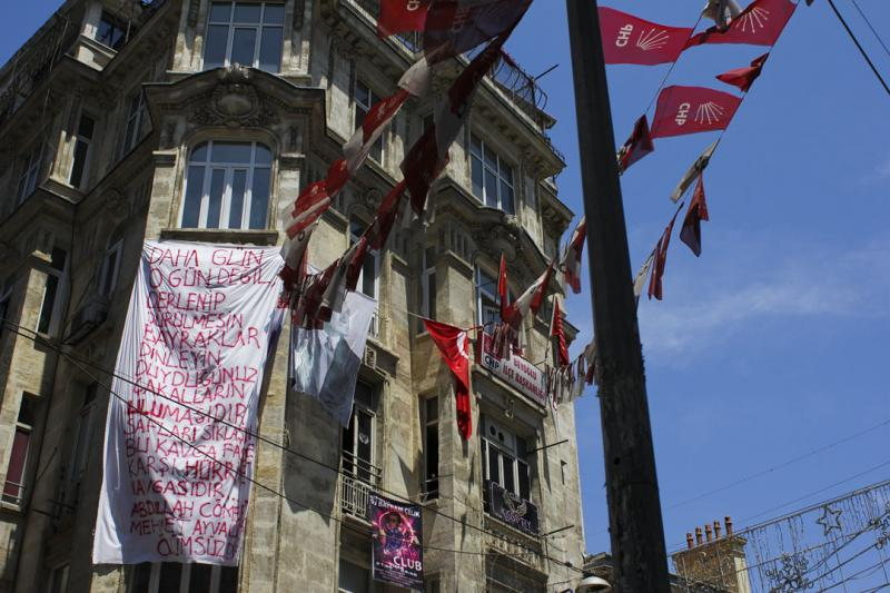 A large poem supporting freedom for the people hangs from a building near the city-center as protesters renew their efforts in Taksim Square on Tuesday.