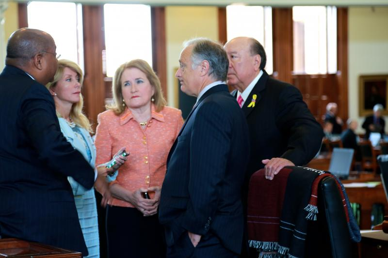 "L-R: State Sens. Rodney Ellis, Wendy Davis, Sylvia Garcia, Juan ""Chuy"" Hinojosa and Kirk Watson huddle before the official start of the 2013 special session's last day."