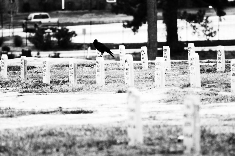 Recent grave markers are shaped like a plank, instead of the crosses that mark older graves at the prisoners' cemetery in Hunstville. The change came after people complained that the crosses promoted a religion not shared by every prisoner.