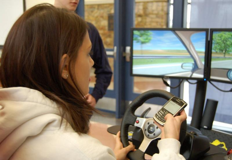A teen attempts a texting-while-driving simulator. The Austin Youth Council is rasing awareness of the issue this weekend.