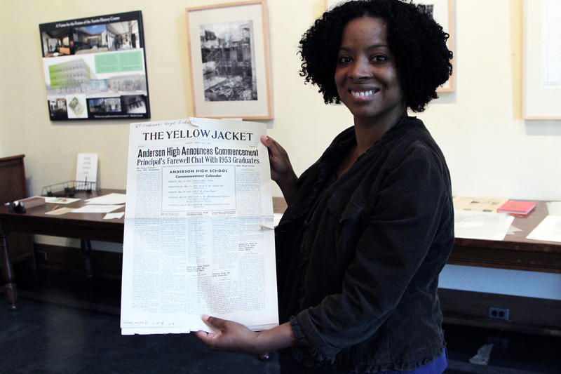 Cynthia Evans holds a newspaper announcing commencement at Anderson High School, Austin's first school for African-American students.