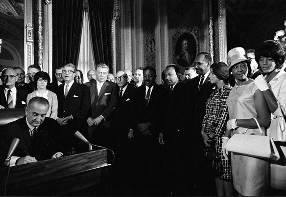 "President Johnson signing the Voting Rights Act in 1965. His daughter, Luci Baines Johnson, says today's decision ""breaks my heart."""