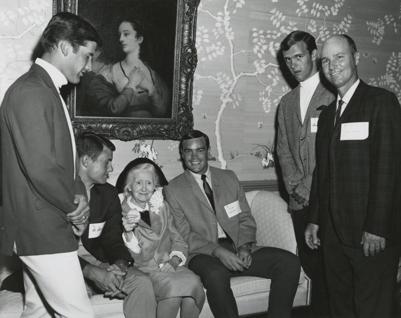 Poet Marianne Moore poses with members of UT's baseball team in this 1968 photo.