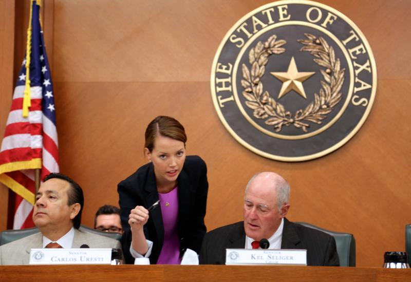 State Sen. Kel Seliger, right, and State Sen. Carlos Uresti at a Senate Redistricting Committee hearing on June 6, 2013.