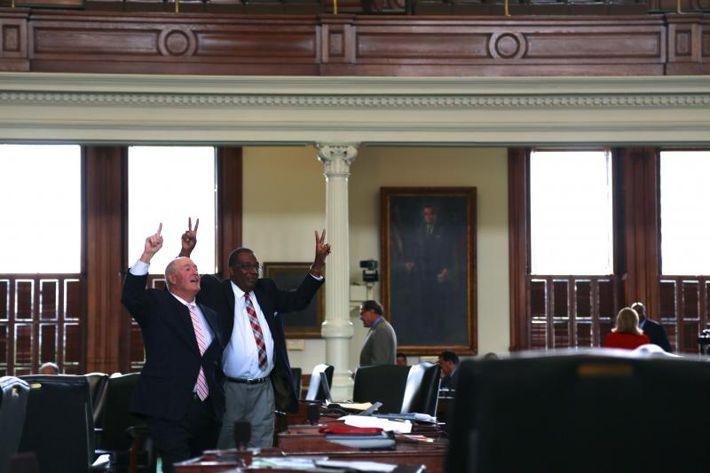 State Sens. Kel Seligerand Royce West during a June 14, 2013 floor vote on redistricting bills.