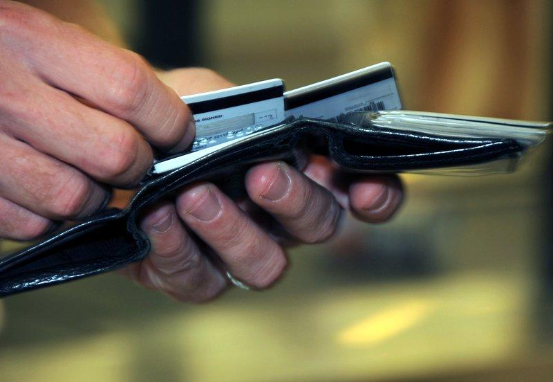 A prohibition on surcharges on debit cards issued by smaller banks takes effect in September.