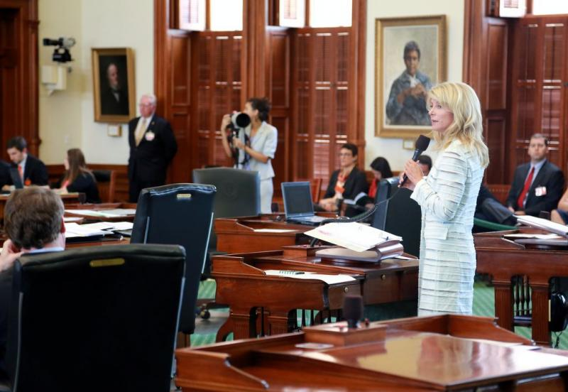 Sen. Wendy Davis, beginning her famous filibuster this summer. The rising political star has postponed a decision on whether to run for governor.