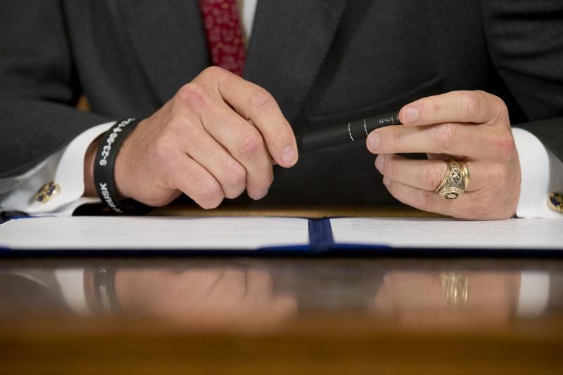Gov. Perry preparing to sign legislation on June 10, 2013.
