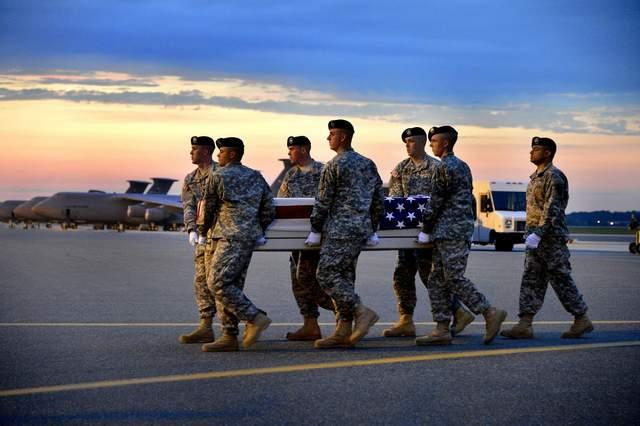 Staff Sgt. Reigoux's remains being transferred at Dover Air Force Base