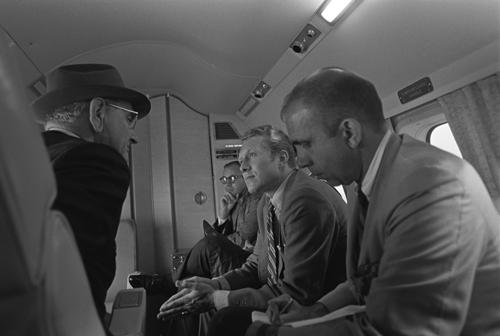 Speechwriter Robert Hardesty listens to President Johnson aboard Marine One in 1968