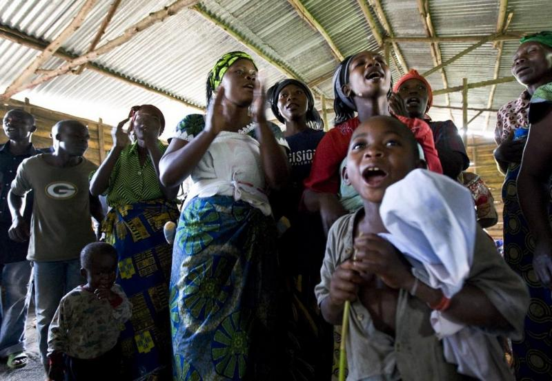 Unnamed Congolese celebrate inside a refugee camp in this photo from 2009. Several Congolese refugees will start settling in Austin and Texas by the end of the year.