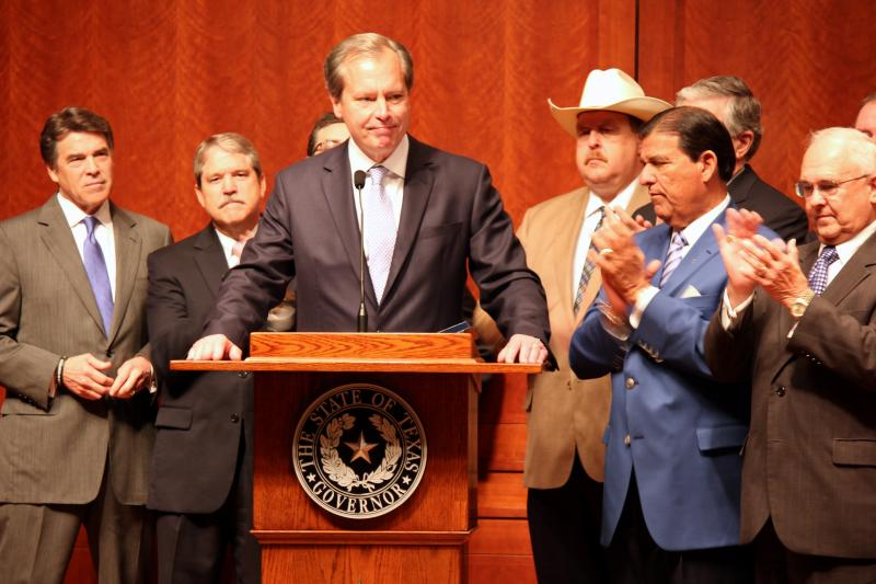Lt. Gov. David Dewhurst speaks before the signing of House Bill 2 on July 18, 2013 at the Capitol.