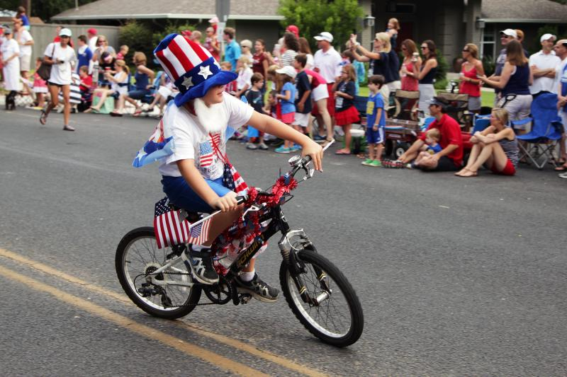 A young Uncle Sam biked his way through the parade.