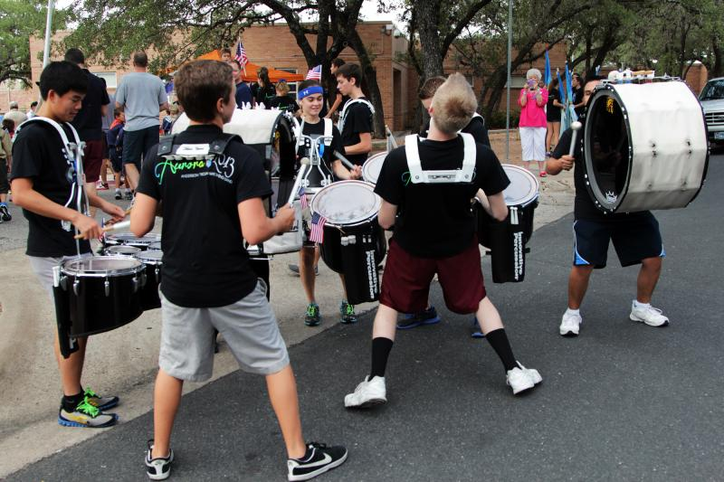 The Anderson High School Marching Band drumline performed at the parade.