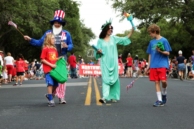 Uncle Sam and Lady Liberty marched down Far West Boulevard.