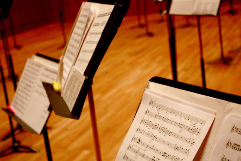 Music notes sit on stands during final rehearsal at the Bates Recital Hall.
